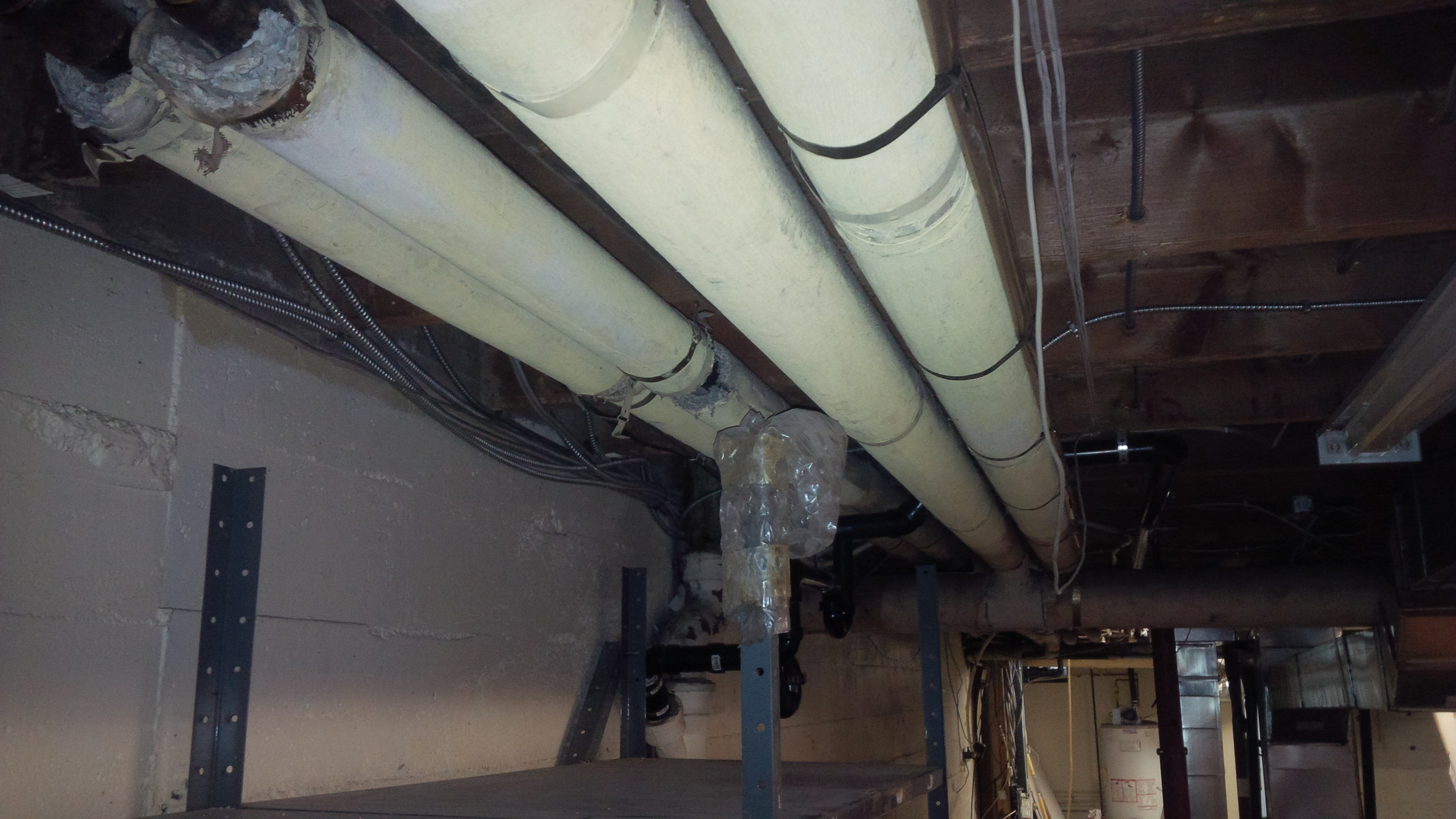 Asbestos Pipe Wrap Elbows, Asbestos Removal, Asbestos Remediation, Asbestos Services,